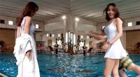 美女脱下浴袍遭一男子偷袭 不料弄巧成拙男子反而掉水里