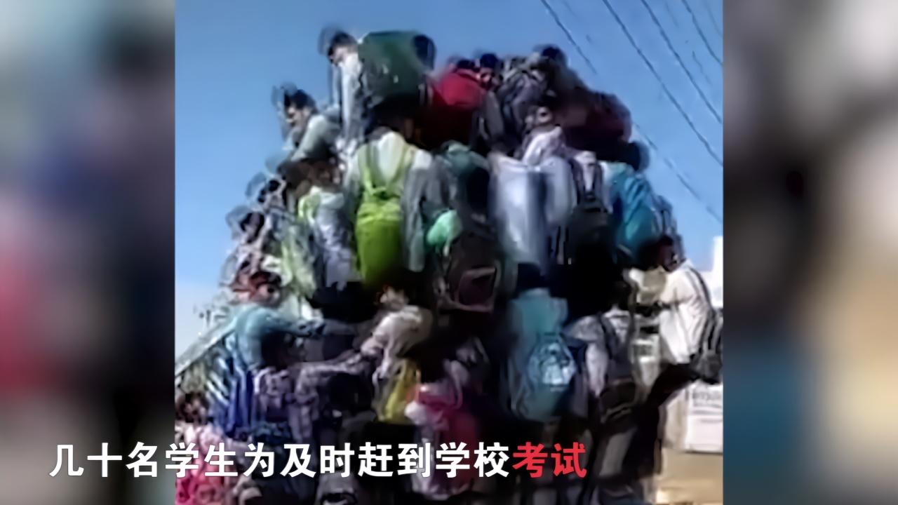 """印度几十名学生""""挂""""公交赶考 1人因体力不支跌落"""