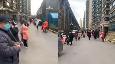 山东济南长清区发生级地震 居民下楼躲避不忘戴口罩